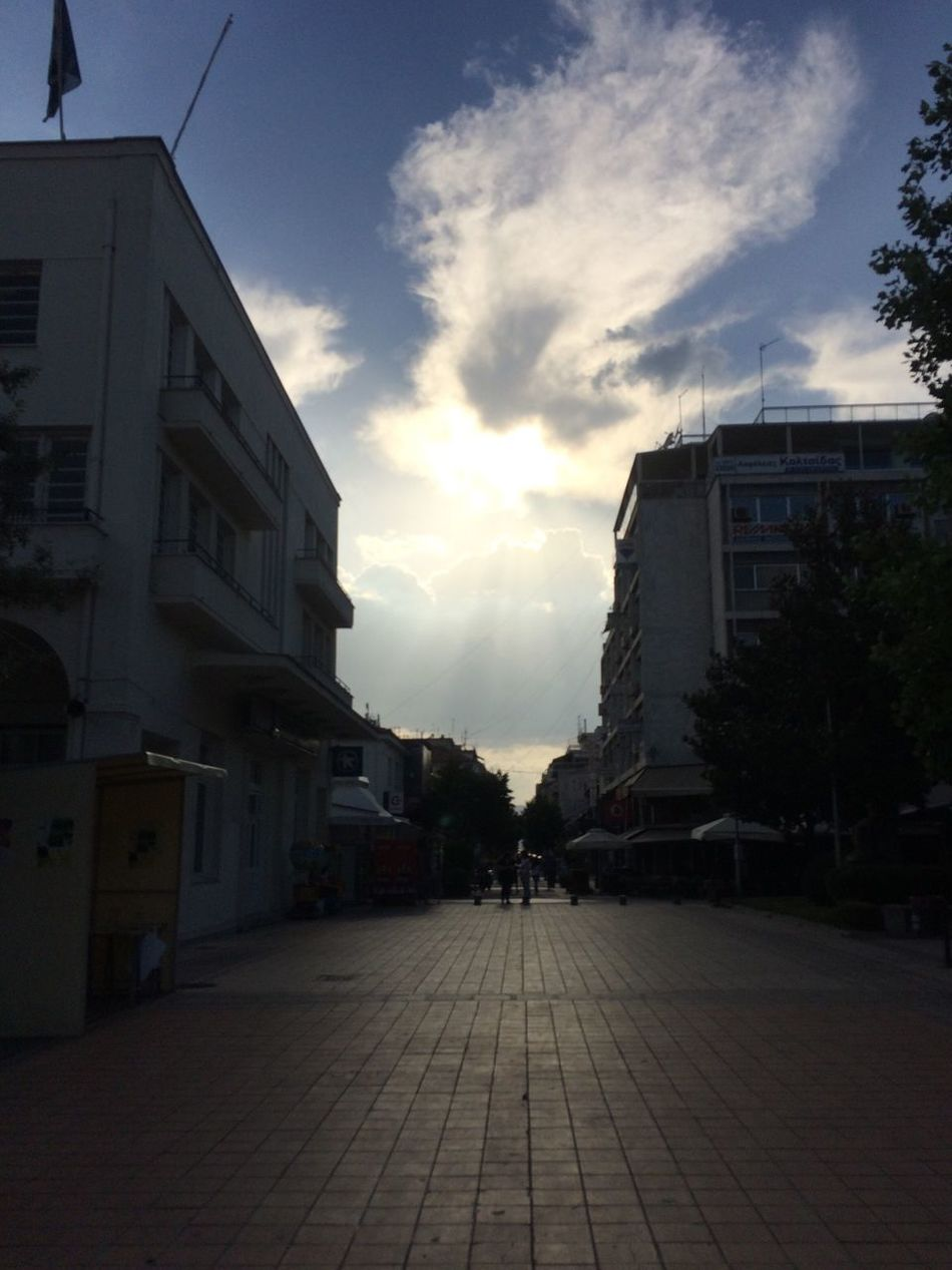 The Way Forward City Walkway Diminishing Perspective Sunlight Outdoors Clouds City Life Buildings Empty Street Residential District Evening in Karditsa  Greece