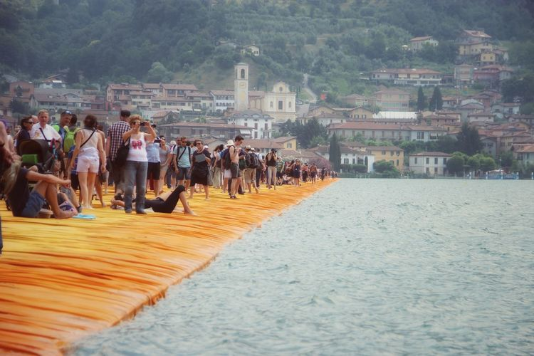 Walking on the Floating piers   Original Experiences People The Floating Piers Getting Inspired The Essence Of Summer Christo And The Floating Piers Point Of View Sunshine 43 Golden Moments Golden Moments  Feel The Journey Tailored To You Lago D'Iseo Showcase July EyeEm Italy  