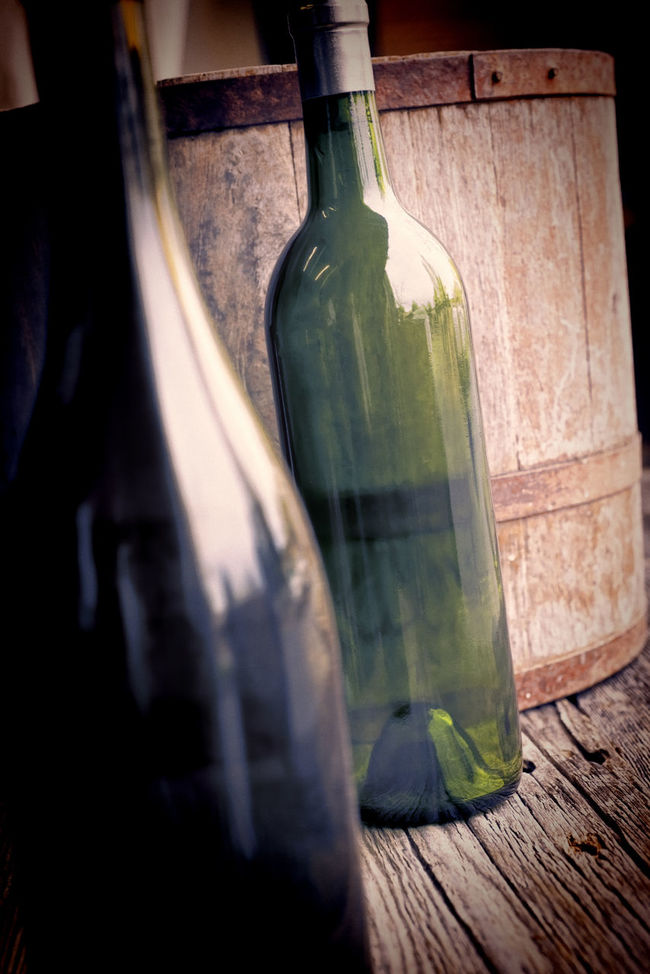 Alcohol Bottles Barrel Bottle Close-up Dramatic Empty Filtered Image Food And Drink Glass Glass - Material Indoors  Painterly Effect Vertical Composition Vignette Wine Bottles Wood Surface Wooden Texture