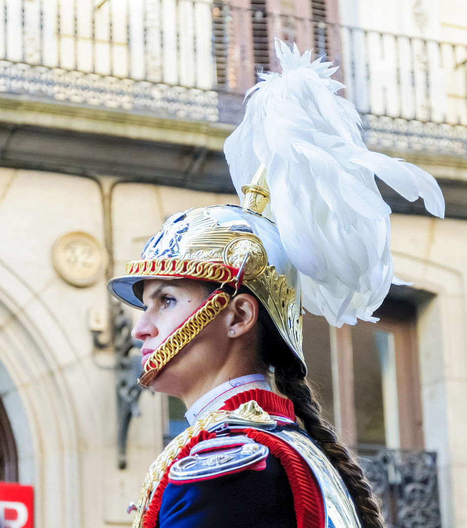 Portrait of a female cavalry soldier in Madrid. Arts Culture And Entertainment Cavalry City Close-up Cultures Editorial  Feather  Guard Headwear Helmet Horse Horses Human Body Part Military Mounted News One Person Only Women People Period Costume Soldier Street Traditional Clothing Uniform Women