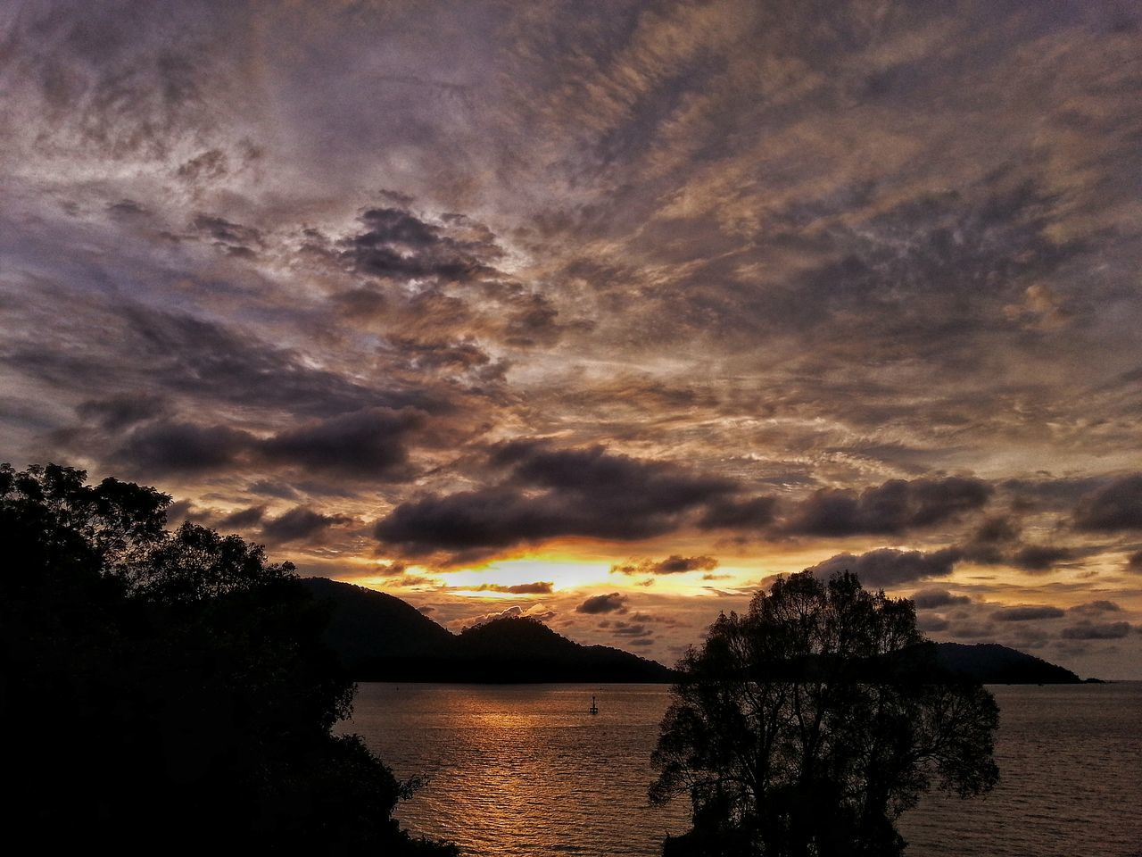 sunset, sky, scenics, tranquility, water, beauty in nature, tranquil scene, nature, cloud - sky, silhouette, no people, reflection, lake, outdoors, tree, mountain, day