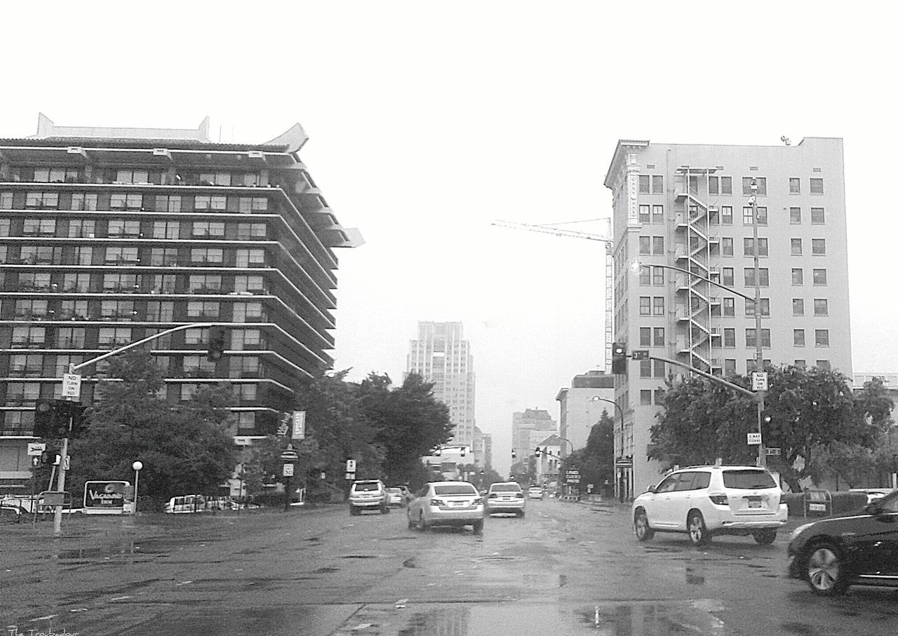 """Black And White """"And more rain is expected for tonight and tomorrow"""" ☔ Rain City Building Exterior Car not my First Eyeem Photo Architecture Street Land Vehicle Built Structure Outdoors Rainy Weather From My Eyes To Yours The Way I See It Monochrome Water Eyeemphotography EyeEm Gallery This Week On Eyeem Best Eyeem Pics Eye4photography  EyeEm Best Shots From My Polnt Of View Rainy Days Rainy Season in Sacramento, CA (USA )"""