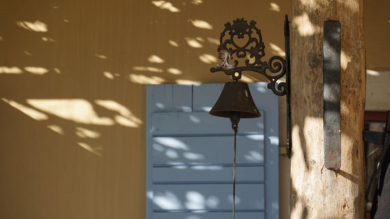 Metallic Bell Mounted On Wood