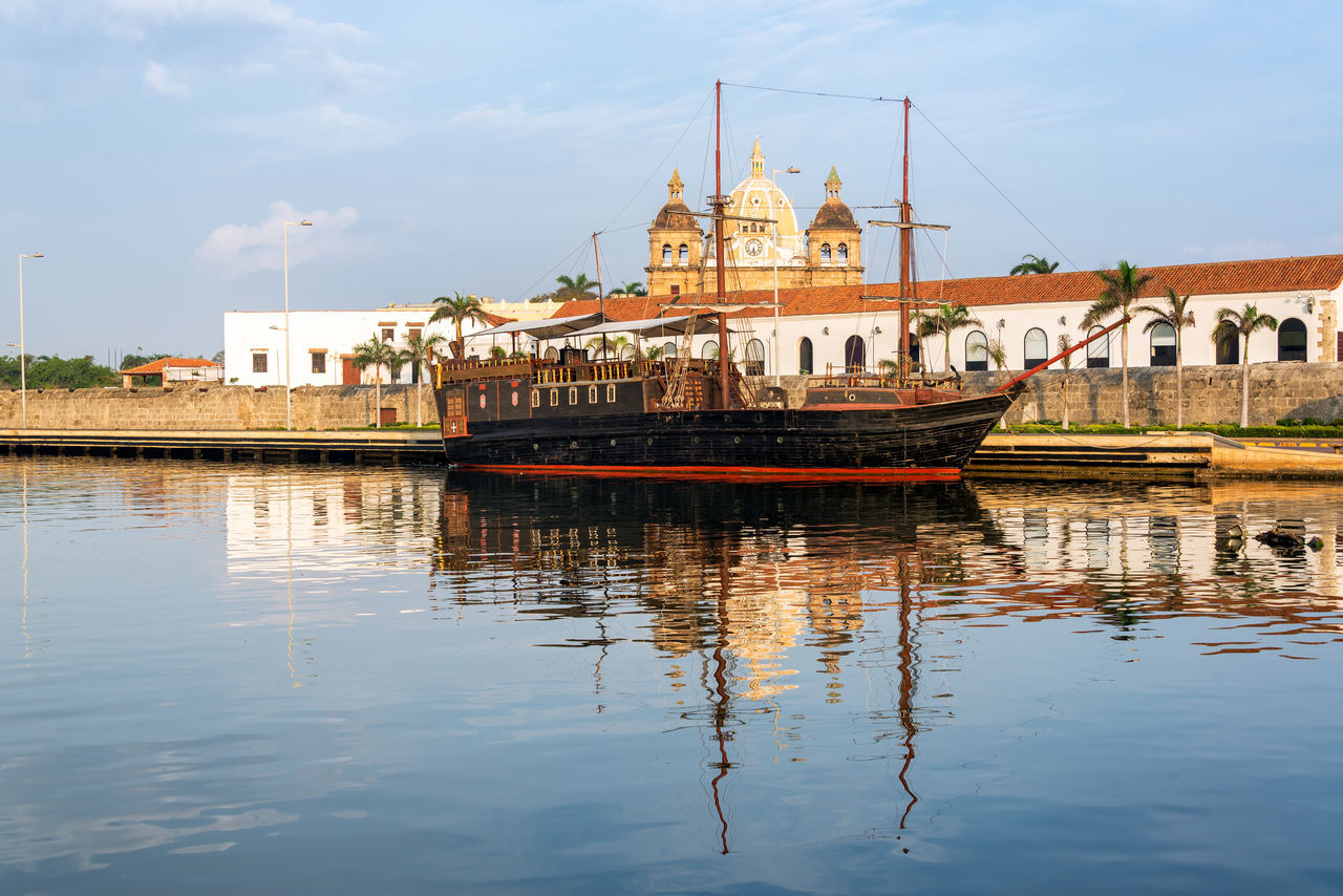Old style pirate ship with San Pedro Claver church in the background in Cartagena, Colombia Boat Bolivar Buccaneer Caribbean Cartagena Center City Cityscape Colombia Colorful Convention Galleon Indias Monument Pirate Pirate Ship Ship Sight Sights Street Tourism UNESCO World Heritage Site Urban Water Waterfront