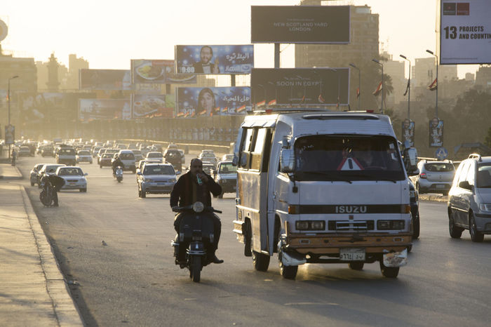 Heavy traffic on the 6th October bridge in central Cairo at dusk. Architecture Building Exterior Built Structure Cairo Car City Congested Crowded Day Egypt Land Vehicle Men Middle East Near East North Africa Outdoors People Real People Road Street Traffic Traffic Jam Transportation