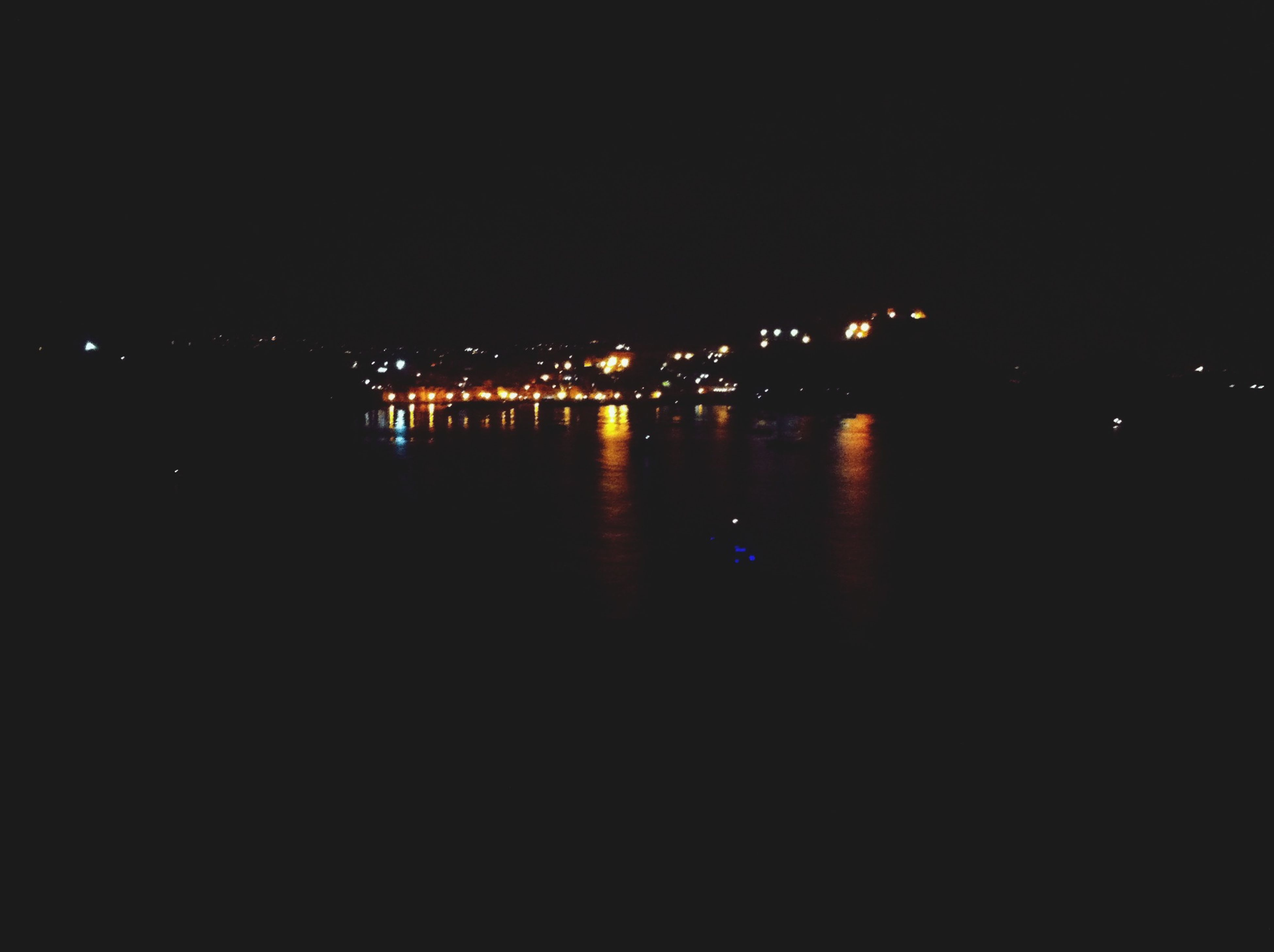 night, illuminated, water, reflection, copy space, clear sky, waterfront, dark, building exterior, built structure, city, river, architecture, sea, no people, outdoors, tranquility, lake, tranquil scene, sky