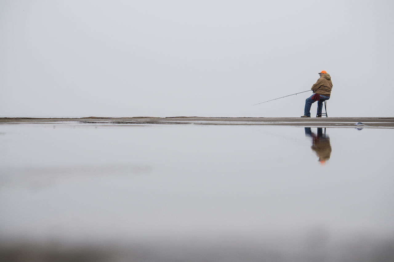 Balance Escapism Fisherman Getting Away From It All Horizon Over Water Horizontal Symmetry Outdoors Puddle Puddleography Recreational Pursuit Reflections Scenics Showcase: January Symmetry Tranquil Scene Tranquility Weekend Activities