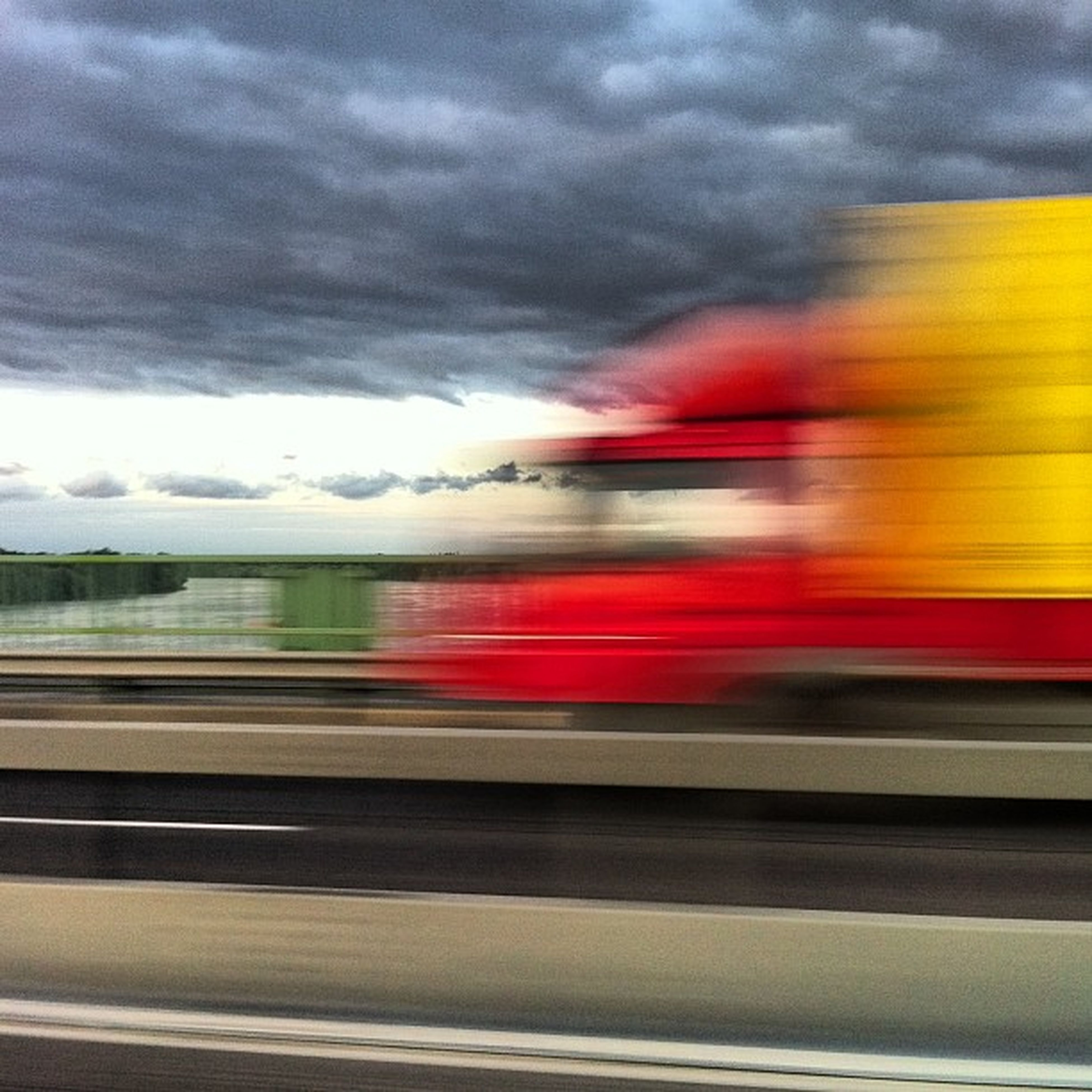 transportation, sky, cloud - sky, mode of transport, road, cloudy, motion, land vehicle, car, blurred motion, on the move, long exposure, speed, weather, travel, dramatic sky, sunset, cloud, road marking, overcast