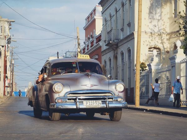Cuban Classic Car in Cienfuegos/Cuba Architecture Transportation Built Structure Building Exterior Mode Of Transport Land Vehicle Street Car Day Real People Outdoors City Sky Cable Road Cuba Cienfuegos, Cuba Neighborhood Map Live For The Story Live For The Story Let's Go. Together.