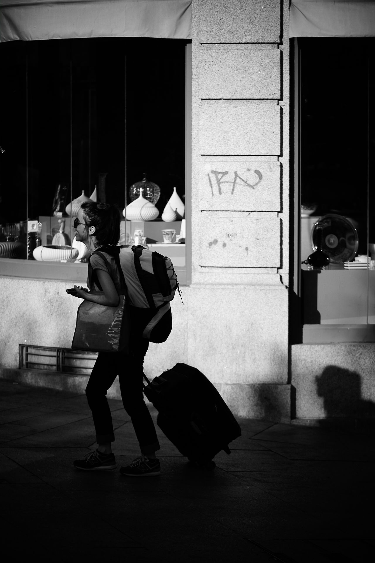 Arriving Adult Archival Bags Black And White Building Exterior Business Finance And Industry Day Full Length Lifestyles Monochrome Photography Outdoors People Person Real People Suitcase Togetherness Tourist Traveler Traveling Two People Vertical Woman