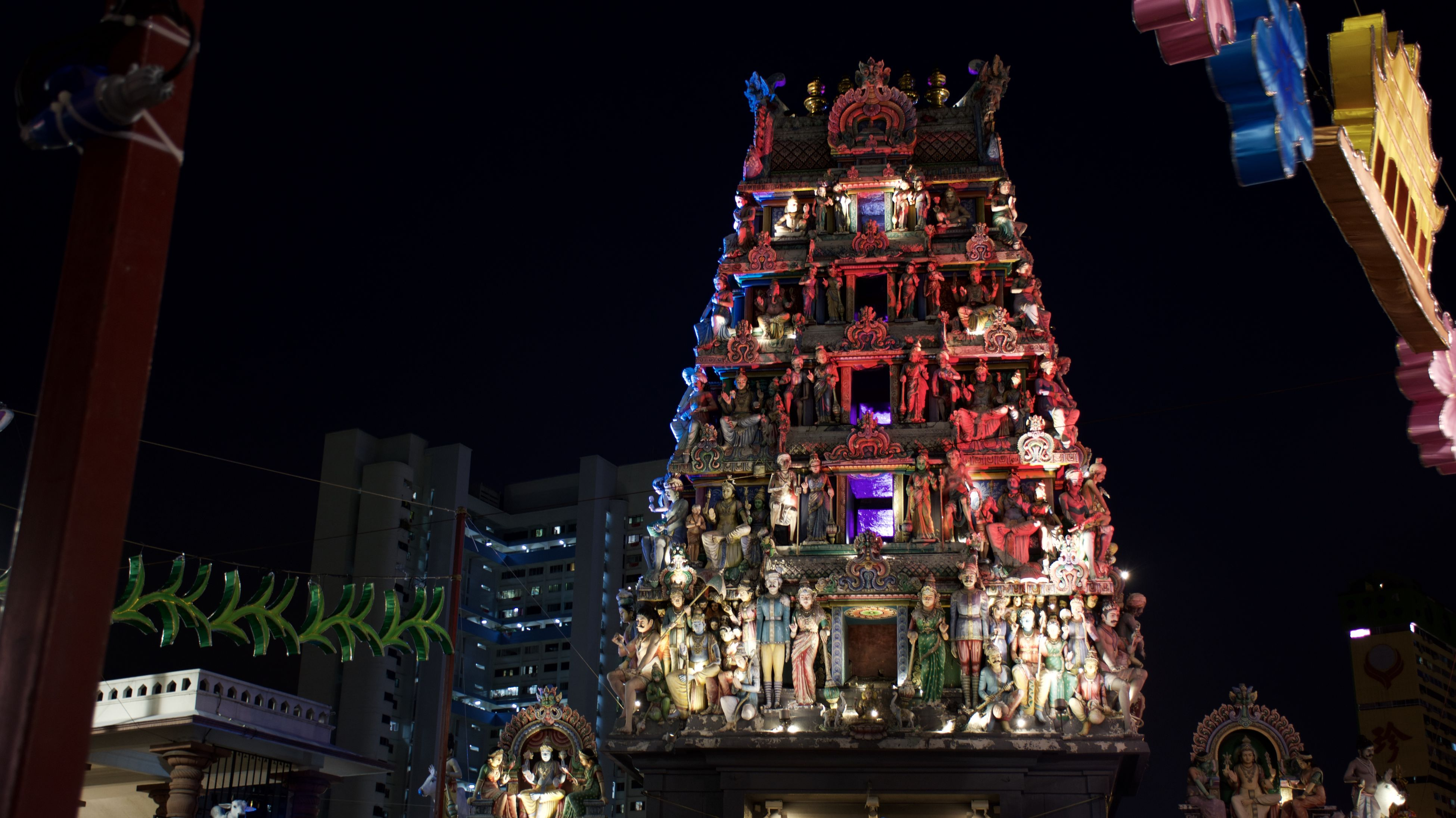 night, illuminated, building exterior, architecture, built structure, low angle view, city, tower, sky, travel destinations, christmas, skyscraper, outdoors, tall - high, city life, tourism, electric light, fairy lights, modern, nightlife