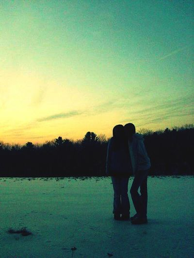 Sky Reflection Two People Love Togetherness Outdoors Nature Sunset People Beauty In Nature Young Adult Snow Winter Trees Trees And Sky