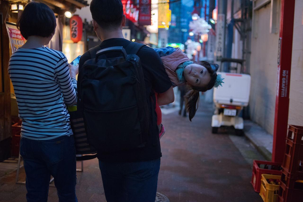 Hey you ! Shinjuku Omoide Yokocho, Tokyo. Adult Child City Hello Kid Night Nightphotography Outdoors People Real People Rear View Shinjuku Street Tokyo Tokyo Street Photography Tokyo,Japan Walking Around Warm Clothing Young Adult