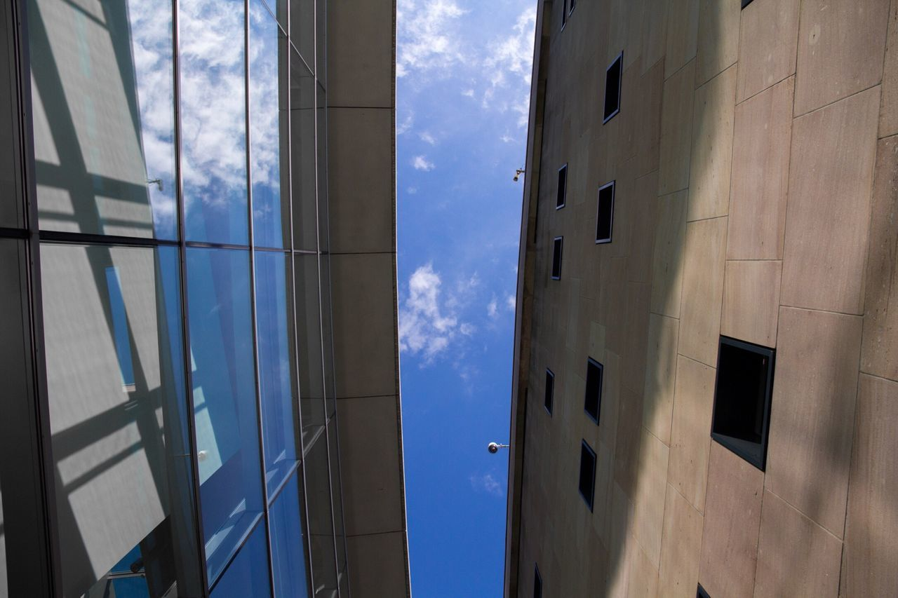 window, sky, architecture, cloud - sky, building exterior, built structure, day, no people, blue, sunlight, low angle view, outdoors, nature