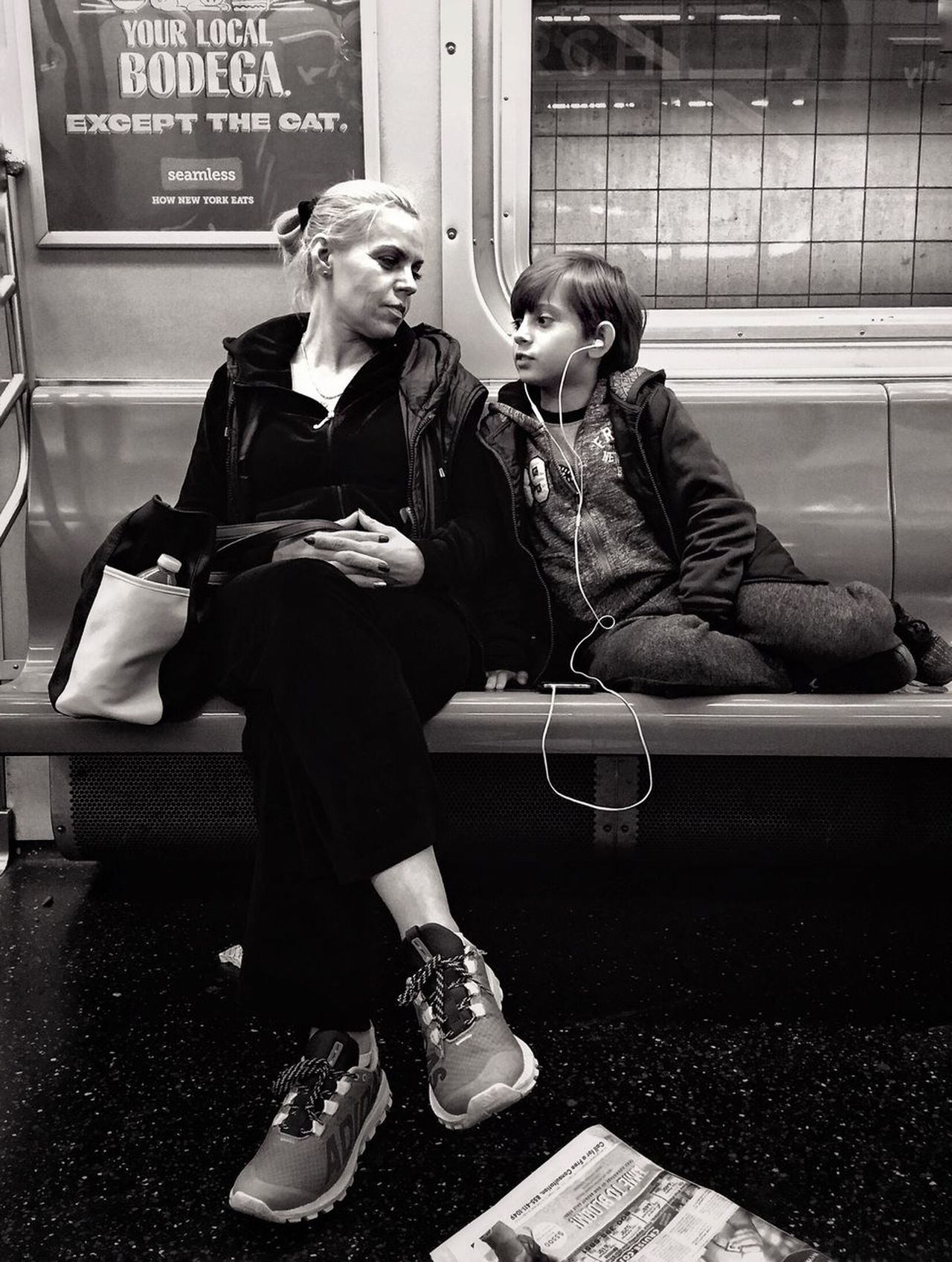 People Of New York Streetphotography Streetportrait Public Transportation Blackandwhite Bnw Two People Young Adult Young Women Real People Full Length Technology Communication Fashion Lifestyles Waiting Indoors  Well-dressed Women Wireless Technology Sitting Suit Night Warm Clothing Friendship Time