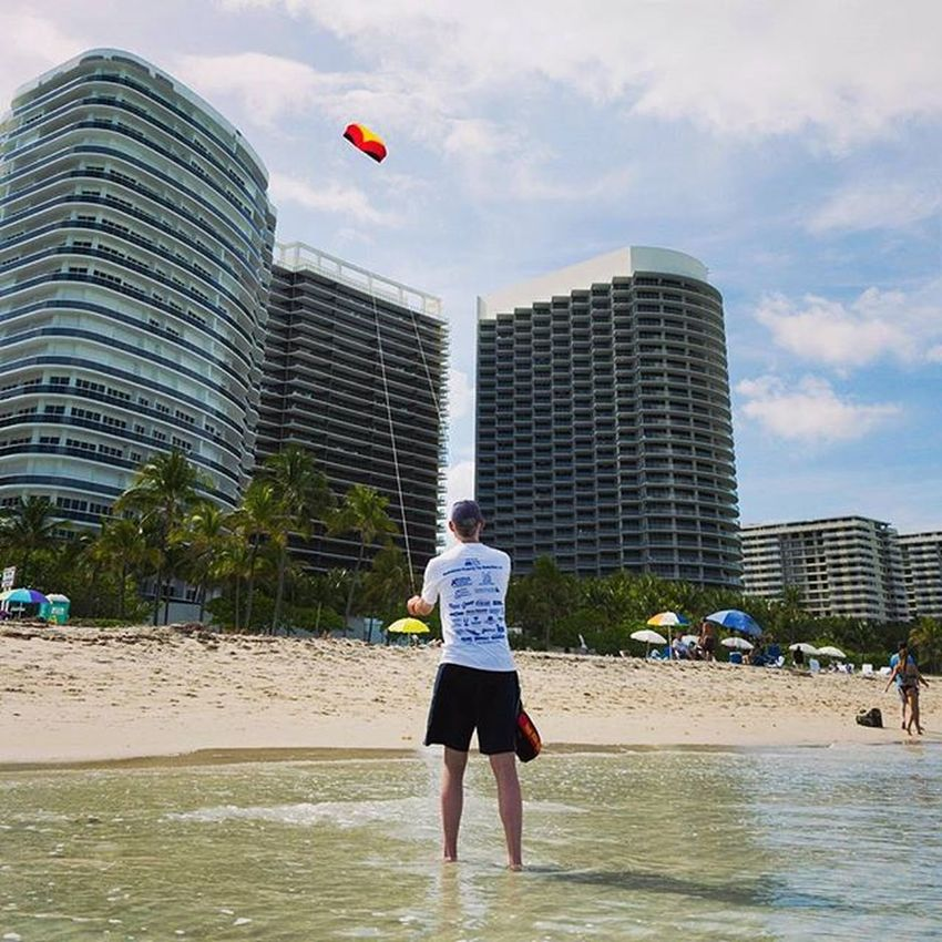 Flying a kite, a simple pleasure. Kite Fly Beach Breeze Relax Relaxation Miami Southbeach High Highrise Simple Pleasure Sand Water Waves Bluesky Sky Sun Wind Florida Nikon Photography People Perspective Getoutside 2015 old