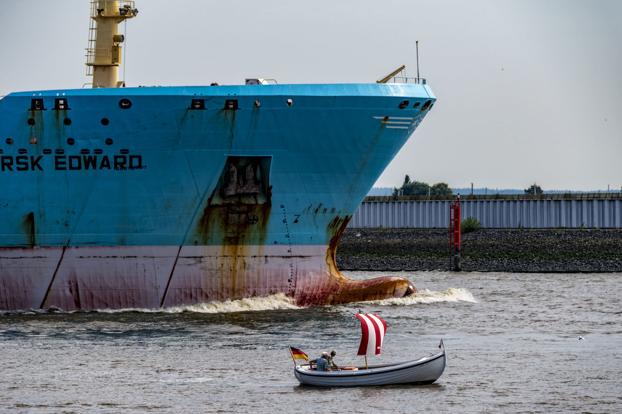 big and small Architecture Big And Small Container Ship Day Elbe River Hamburg Harbour Little Boat Men Nature Nautical Vessel Nutsshell One Man Only One Person Only Men Outdoors People Sea Sky Transportation Water