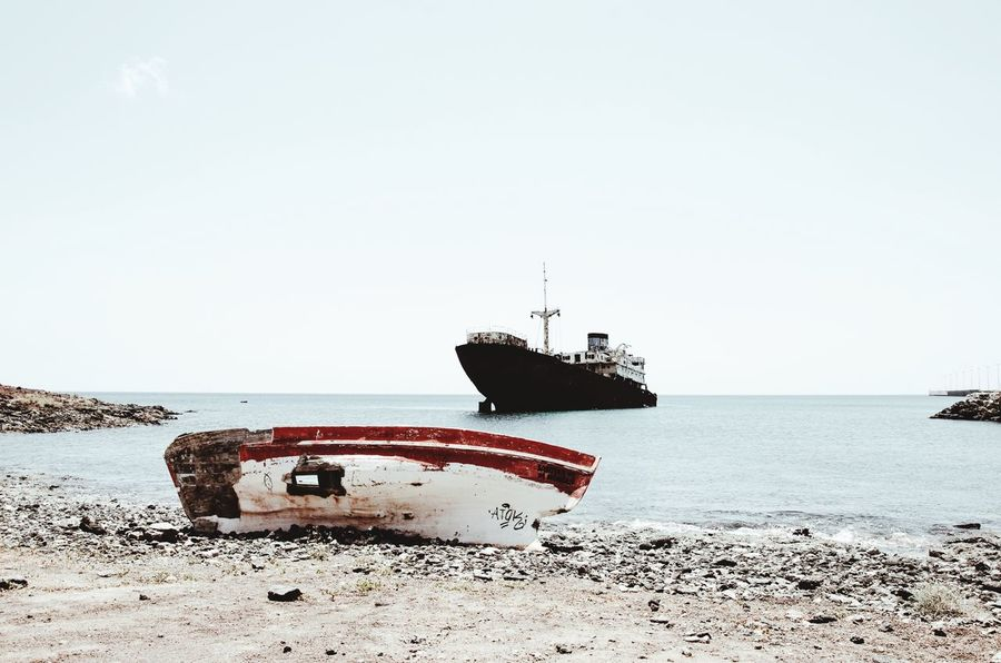 Transportation Boat Sand Sea Beach Nautical Vessel Mode Of Transport Horizon Over Water Old Shore Abandoned Islas Canarias Copy Space Tranquility Barco Vscocam EyeEm Nature Lover Discard Lanzarote Water Tranquil Scene Ocean Weathered Outdoors Obsolete