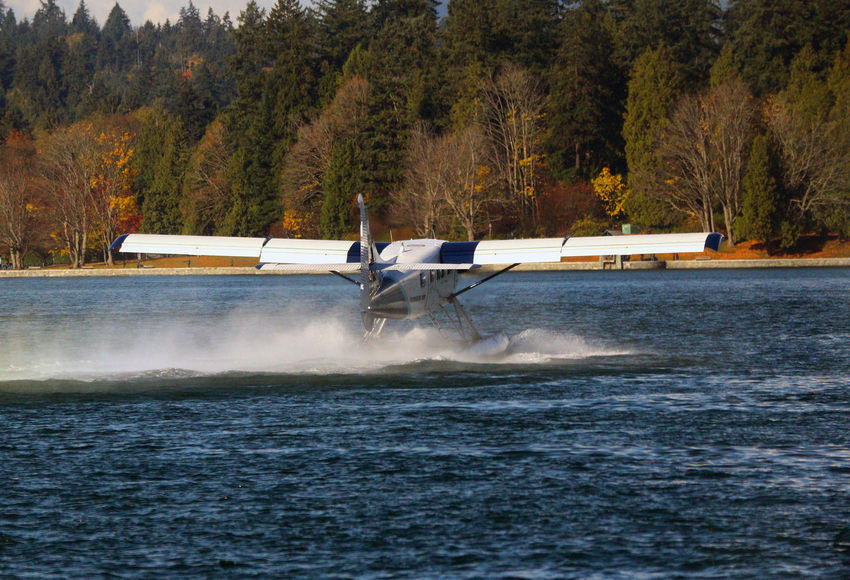 Sea plane taking of from Burrard Inlet near Vancouver B.C. Canada. Sky Water Sea Plane vancouver bc