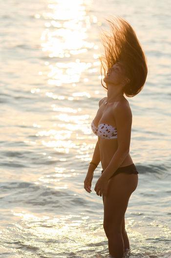 Beach Beautiful Beautiful Girl Bikini Blonde Casual Clothing Childhood Elementary Age Girl Innocence Leisure Activity Lifestyles Person Sand Sand & Sea Sea Shine Side View Standing Summer Sun Sunlight Sunset Sunset #sun #clouds #skylovers #sky #nature #beautifulinnature #naturalbeauty #photography #landscape Water