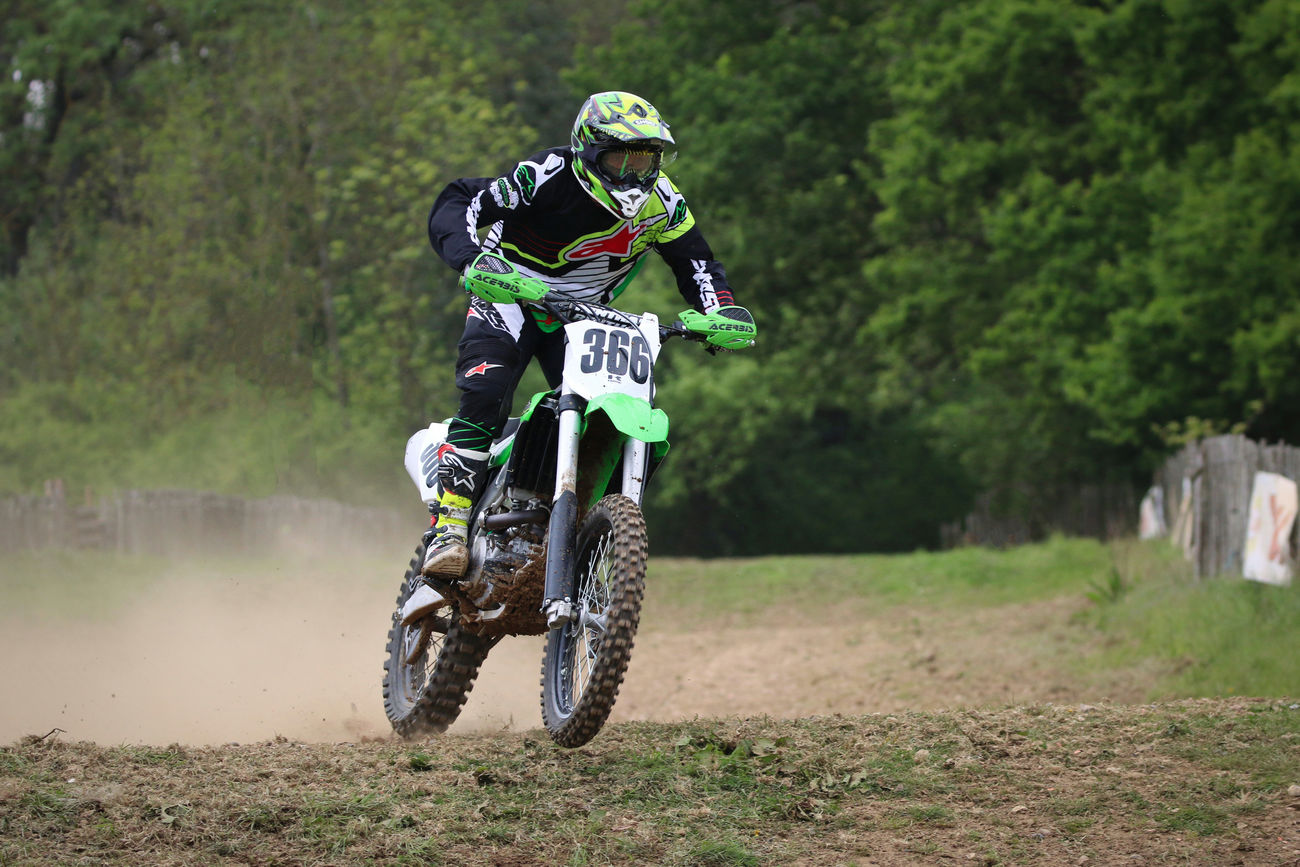 Motocross Rider Adventure Competition Crash Helmet Day Extreme Sports Full Length Headwear Helmet Men Motocross Motorcycle Motorsport One Man Only One Person Outdoors People Real People Riding Skill  Speed Sport Sports Clothing Sports Helmet Sports Race Transportation