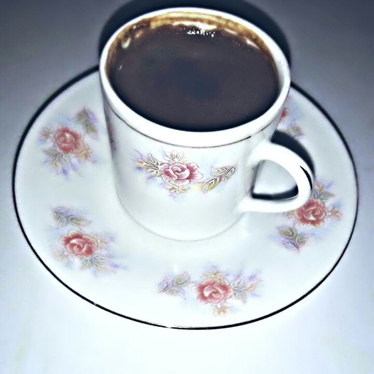 coffee cup, coffee - drink, saucer, drink, food and drink, refreshment, table, no people, high angle view, freshness, close-up, indoors, food, cappuccino, flower, day