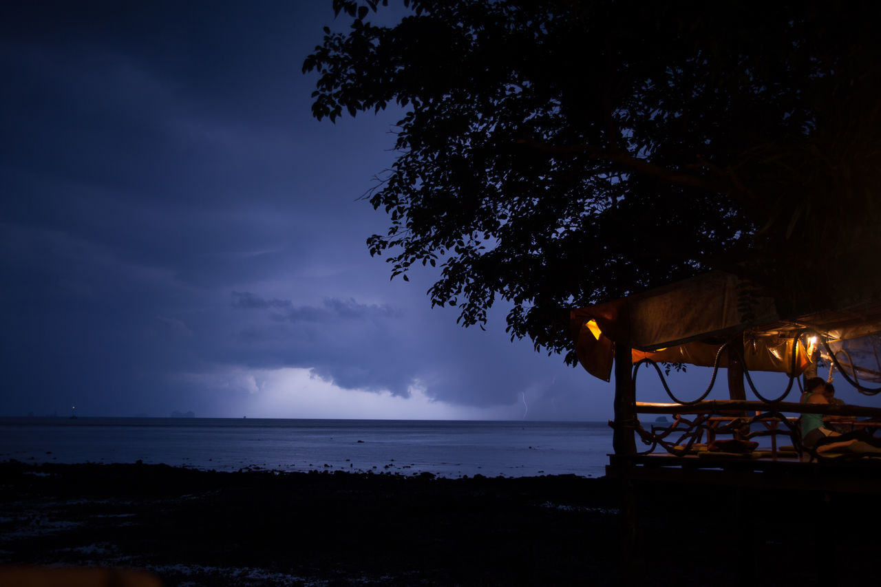 Scenic View Of Sea Against Thunderstorm At Night