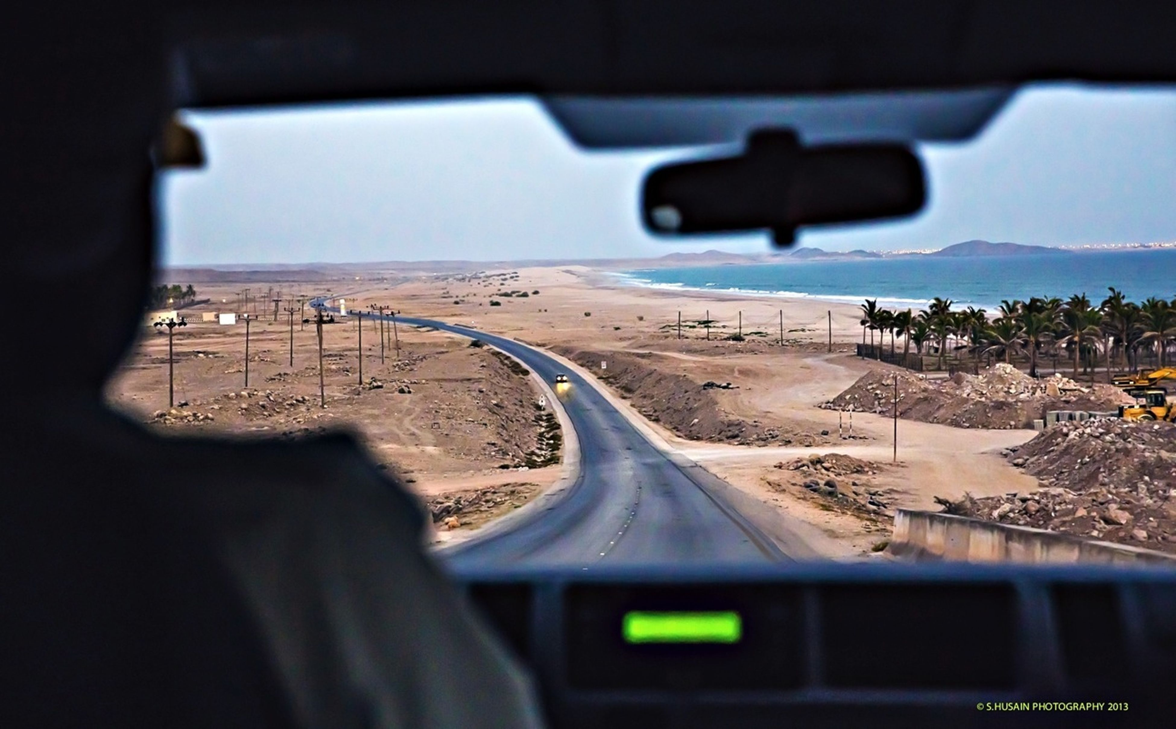 transportation, vehicle interior, mode of transport, landscape, travel, land vehicle, car, road, sky, part of, transparent, cropped, journey, window, sea, glass - material, nature, day, windshield, horizon over water