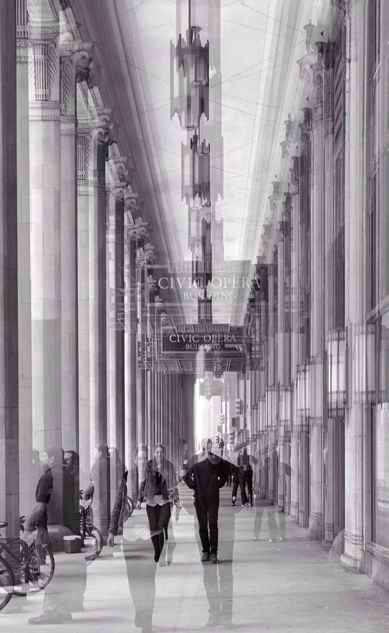architectural column, architecture, real people, built structure, men, pillar, walking, indoors, women, large group of people, travel, travel destinations, lifestyles, day, building exterior, city, adult, people, adults only