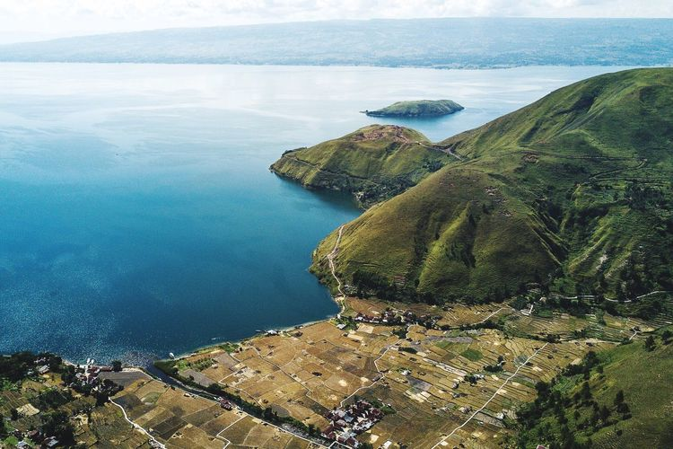 The Beautiful Toba Lake Indonesia High Angle View Water Nature Scenics Day Tranquil Scene Beauty In Nature Tranquility Landscape Outdoors No People Mountain Aerial View Built Structure Sky Travel Destinations Tree TOBALAKE Pesonaindonesia Toba Wonderful Indonesia Sitapigagan Bonandolok Tobadream