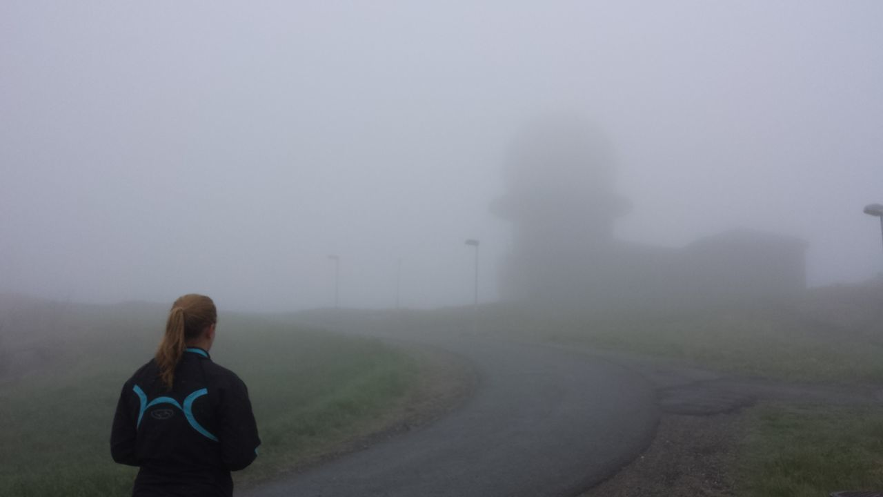 Fog Weather Rear View Foggy Standing Road Tranquility Waist Up Tranquil Scene Solitude Remote Sky Non-urban Scene Scenics Country Road Day Countryside Beauty In Nature Alone Person Norway Spooky Atmosphere