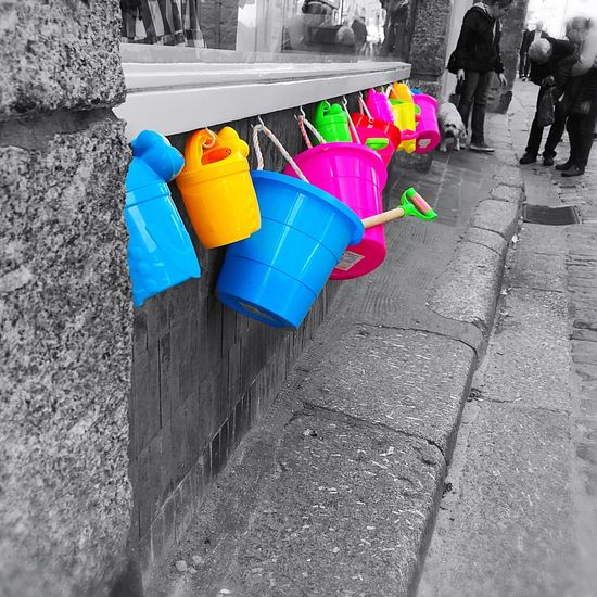 Summer Is Here Plastic Outdoors Multi Colored Low Section Buckets And Spades Beach Accessories I Love Colour Colour Pop Stone Wall Hanging Objects People Shopping Retail Display Close-up I Love Colours