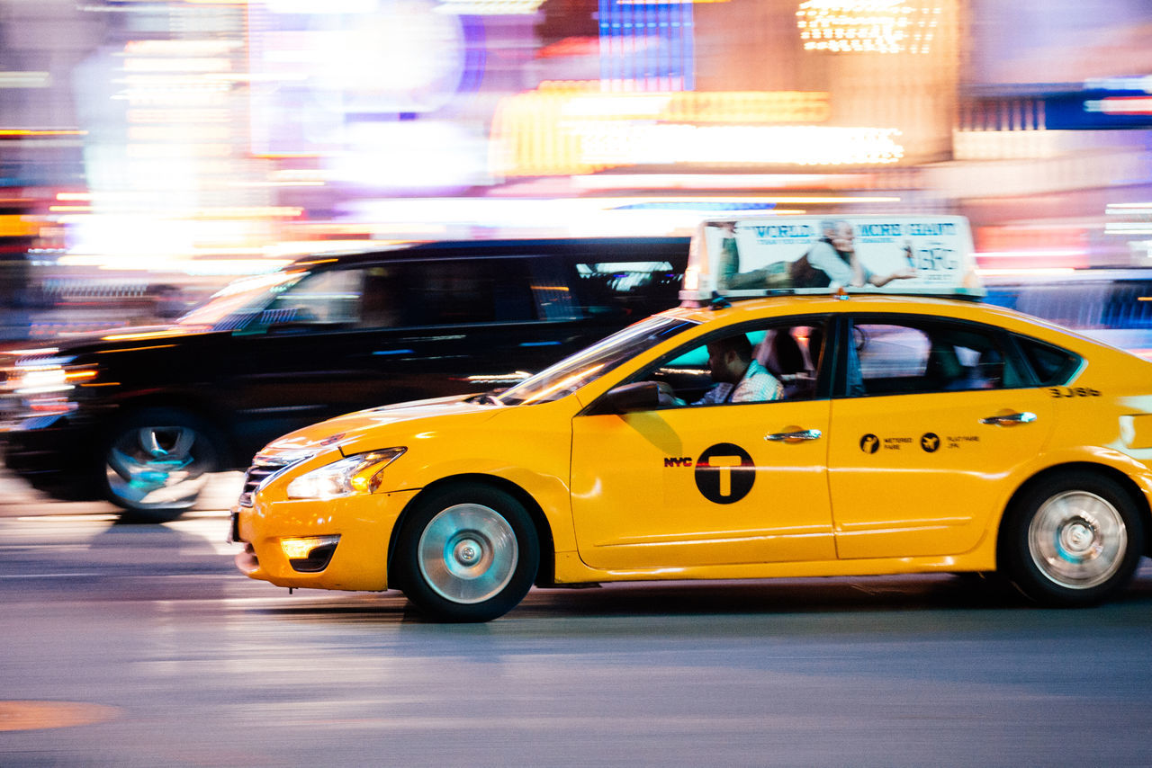 car, transportation, taxi, mode of transport, illuminated, land vehicle, yellow taxi, night, city, police force, outdoors, building exterior, architecture, no people