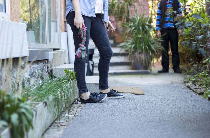 Casual Clothing Day Full Length Leisure Activity Lifestyles Low Section Men Outdoors Person Plant Rear View Selective Focus Shoe Standing Tree Urban Spring Fever Walking Week On Eyeem
