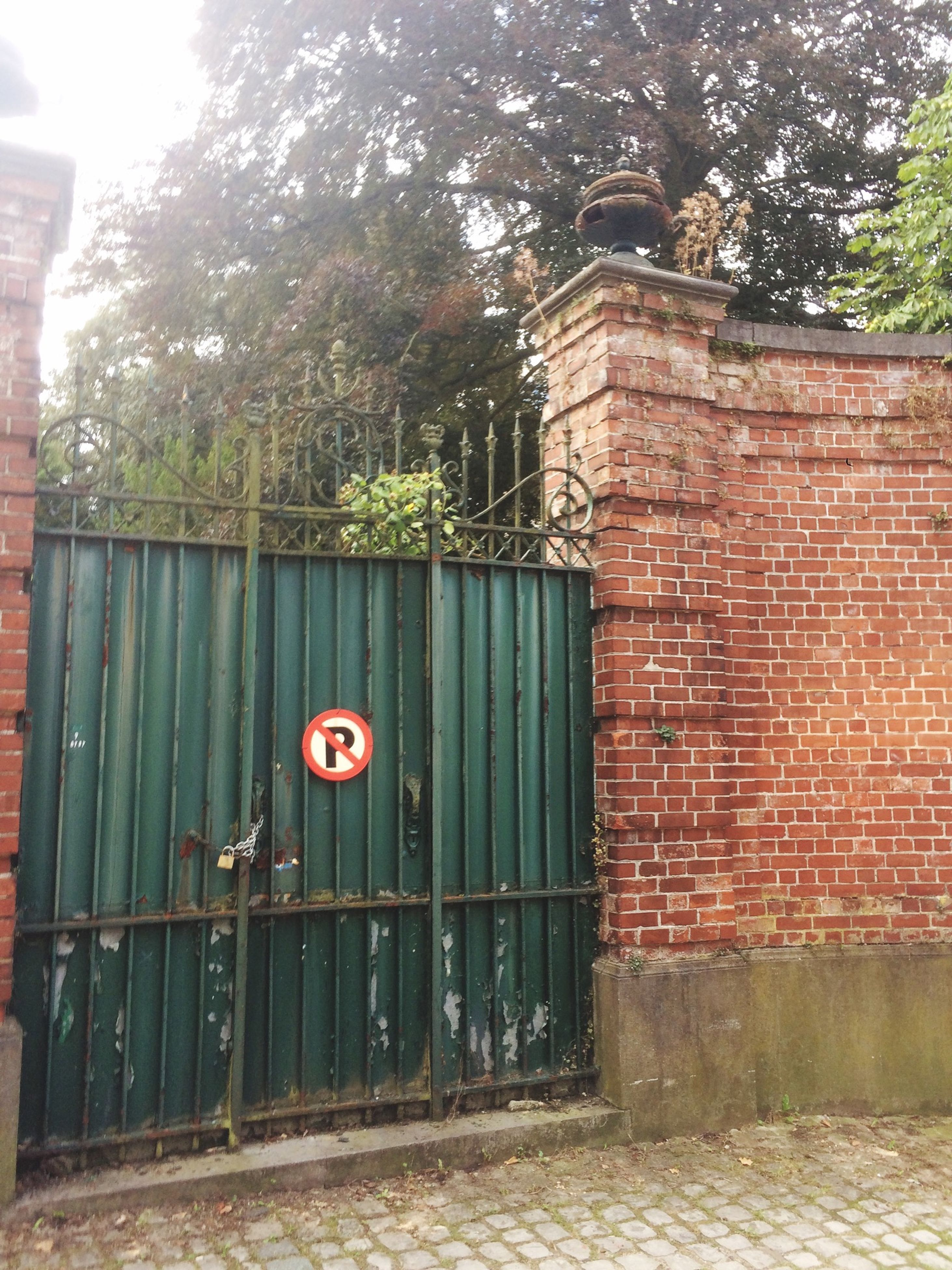 building exterior, architecture, built structure, red, door, closed, entrance, house, tree, brick wall, safety, window, protection, wall - building feature, security, day, outdoors, gate, wood - material, no people