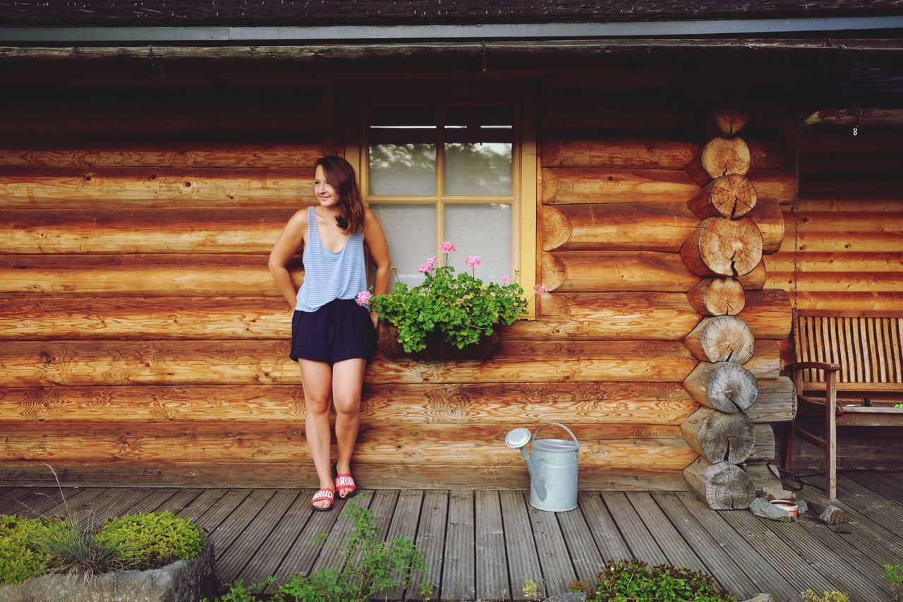 Wood - Material Adilette Brudi Full Length Wood Wooden House Standing House Architecture Architecture_collection Houses Young Adult Outdoors Woman Woman Portrait Germany Real People Lifestyles Women Building Exterior Day Architecture Hang Around Wasting Time Summer