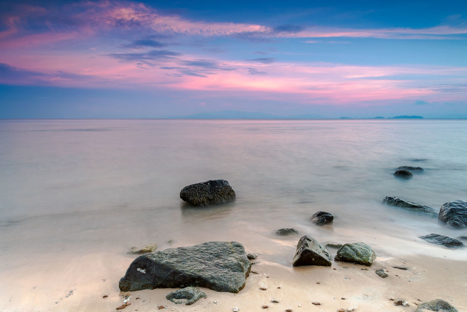 Beautiful seaside with clear water. Beach Boulders Calm Clear Water Day Gentle Horizon Over Water Landscape Nature No People Outdoor Outdoors Peaceful Rocks Sand Scenery Scenics Sea Seascape Shore Sunset Water Miles Away