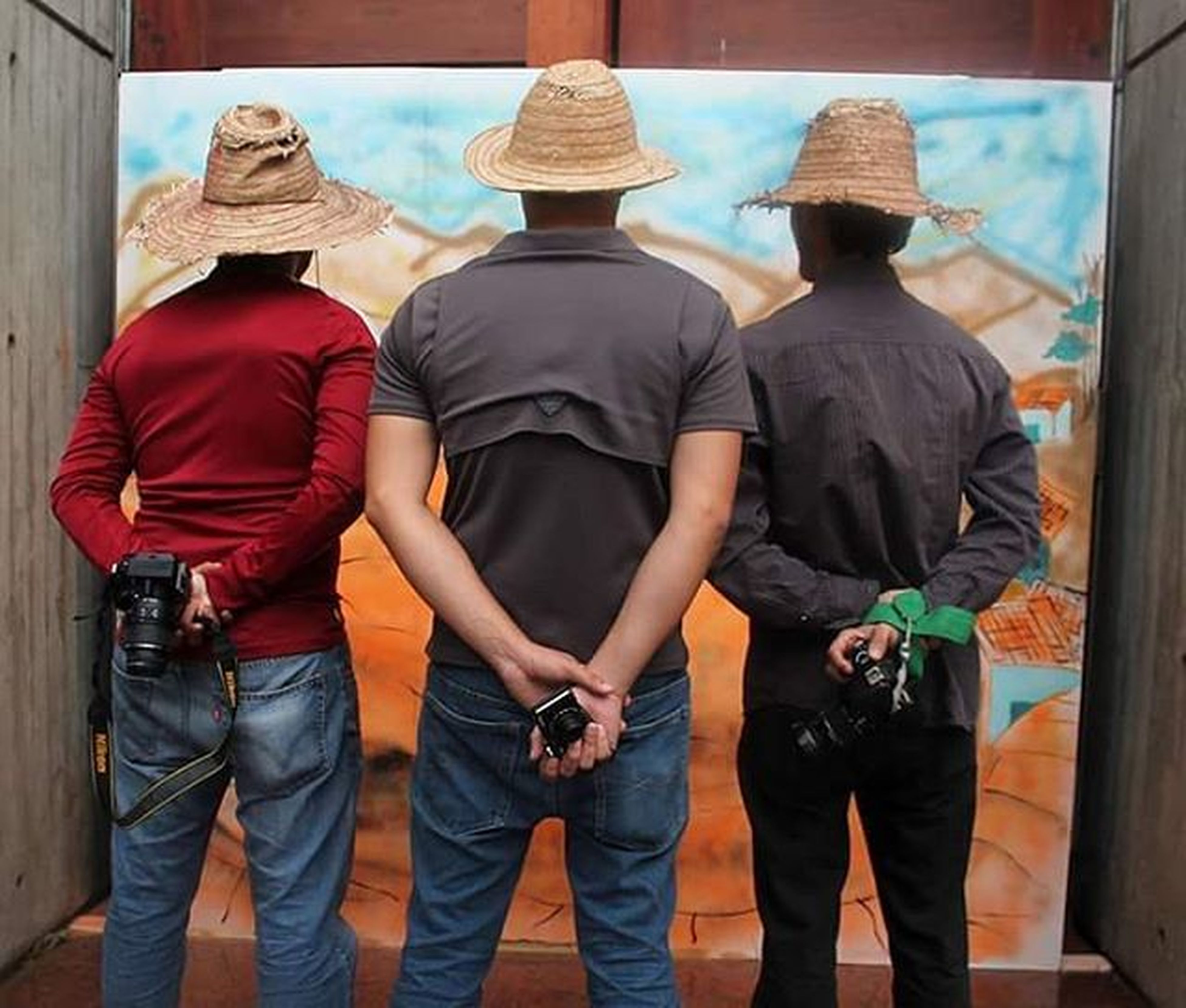 men, lifestyles, casual clothing, rear view, standing, togetherness, leisure activity, person, warm clothing, indoors, medium group of people, sitting, full length, travel, day, blue, bonding