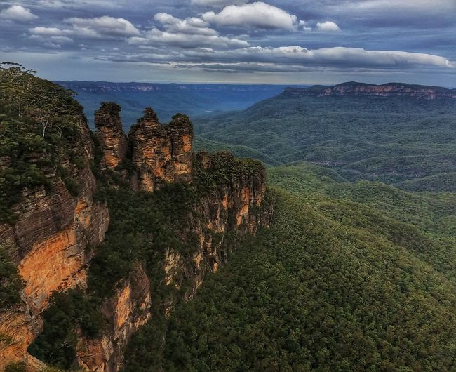 The Three Sisters Rock Formation on the north Escarpment of the Jamison Valley Blue Mountains New South Wales  Australia Ten minutes after this shot, the storm clouds rolled in and the view was completely obliterated. I was glad I'd previously decided not to stop for a coffee. 11,500 miles is just too far to come only to miss such a scene! A Bird's Eye View Exceptional Photographs Striving For Excellence Nature Photography Nature Lover EyeEm Best Shots EyeEm Nature Lover Mountains Landscape_Collection Mountain View Australian Landscape (Not quiteNature On Your Doorstep) 😄👍 Hikingadventures Travel Photography Wanderlust My Cloud Obsession☁️ Malephotographerofthemonth Three Sisters