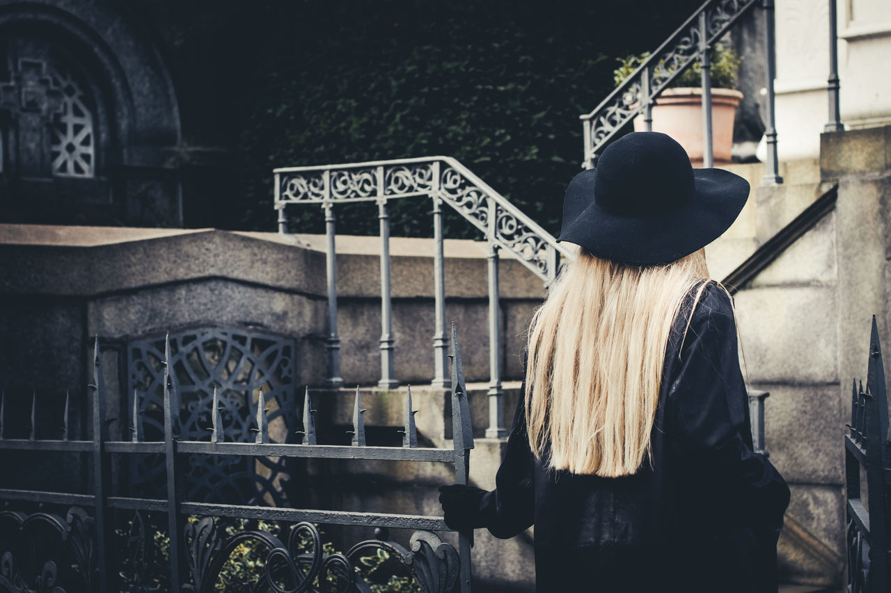 Blond girl in black, Cimitero Monumentale di Milano Alone Ancient Ancient Architecture Black Blond Hair Building Dark Darkness Darkness And Light Enter Entrance Italy Lonely Long Hair Milan Mysterious Mystery One Person One Woman Only Outdoors People Rear View Scary Steps Young Adult
