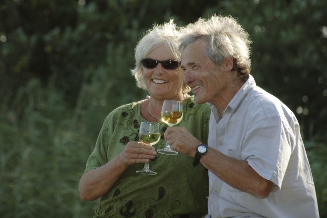 Happy Senior Couple Having Drink Outdoors