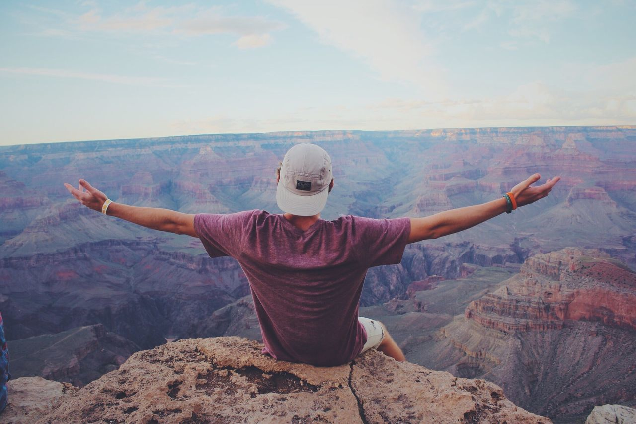 My Year My View The Grand Canyon was thiiiis big 😳 Rock - Object Arms Outstretched Mountain Rear View Mountain Range Scenics Landscape Travel Sky Nature Men Real People Beauty In Nature Outdoors Leisure Activity Lifestyles Arms Raised One Person Day Vacations