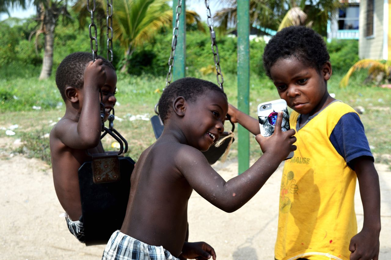 Mesmerized Ej Seine Bight, Belize Service Work People And Places Children Chilhood Children Playing Poverty Enjoying The Moment Hanging Out Taking Pictures Enjoying Life Yellow