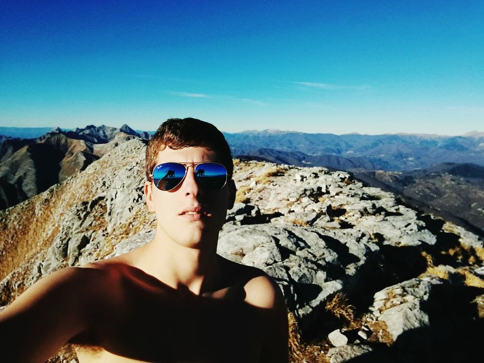 On the top!! Sunglasses Blue One Person Adult Adults Only Mountain TrekkingDay Landscape Nature Beauty In Nature Apuane Mountains Mountain Peak Passion