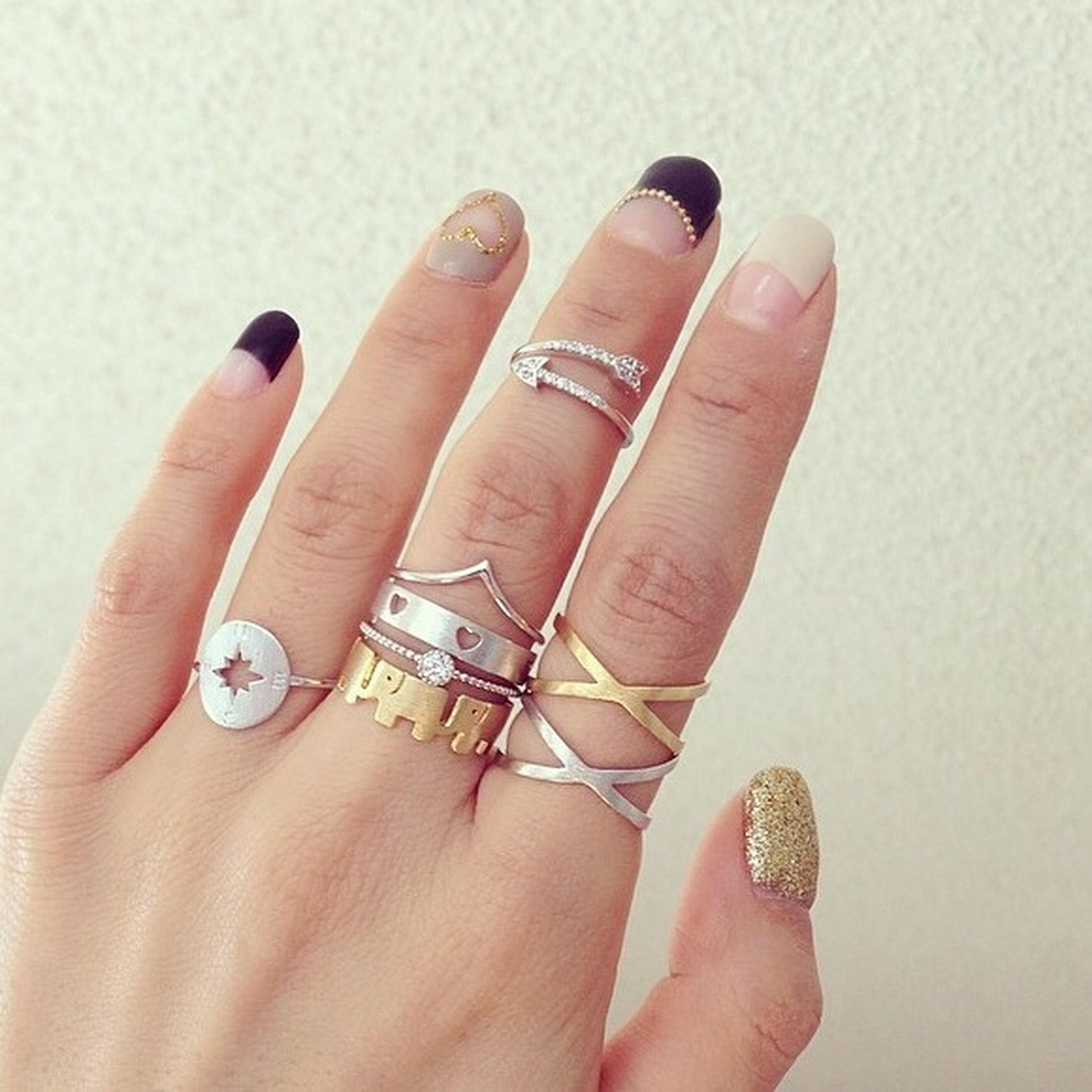 person, part of, holding, human finger, personal perspective, indoors, nail polish, cropped, close-up, ring, studio shot, lifestyles, unrecognizable person, showing, white background, palm