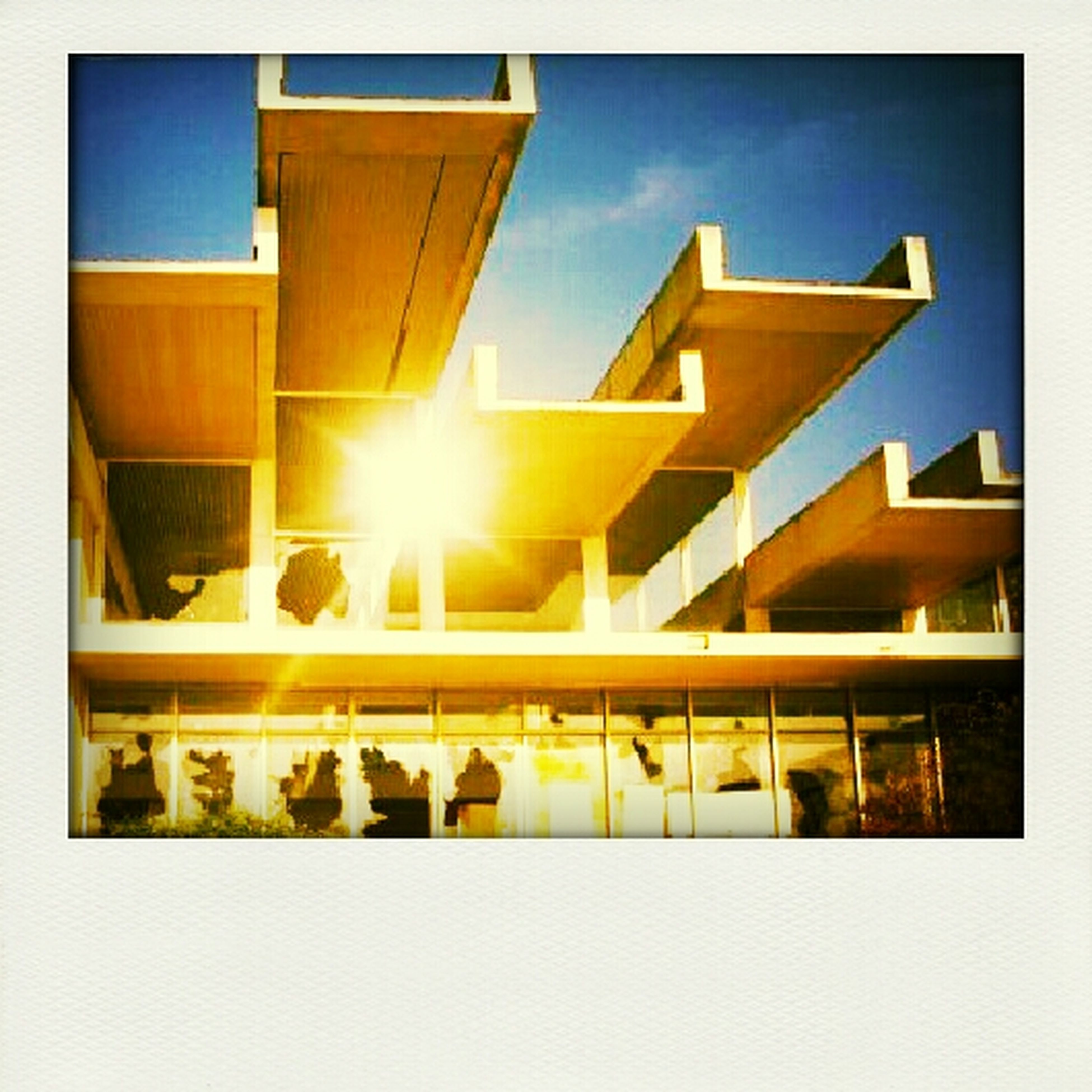 transfer print, auto post production filter, architecture, built structure, building exterior, sunlight, in a row, sky, reflection, low angle view, arrangement, window, blue, side by side, large group of objects, day, no people, repetition, building, balcony