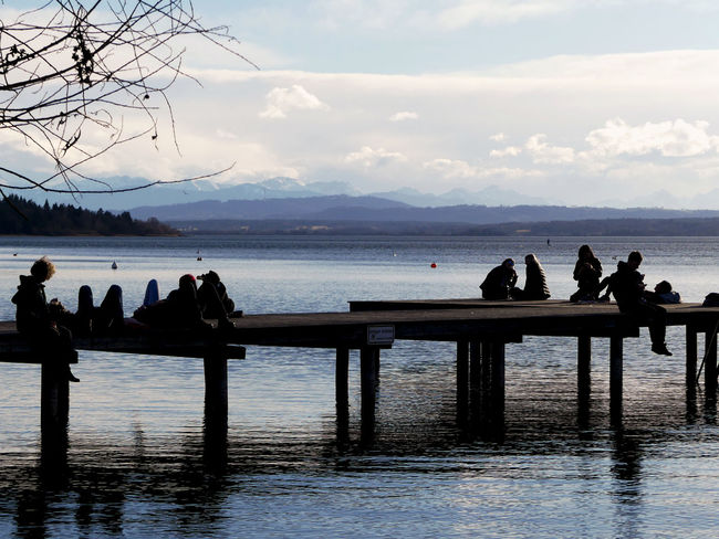 Ammersee Bavarian Lakes Beautiful Germany Landing Stage Mountains In The Background People Silhouette Socializing Togetherness Steg German Lakes Real People Bavarian Landscape Silouette & Sky