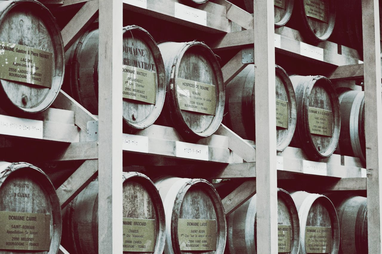 no people, in a row, wine cellar, indoors, abundance, large group of objects, winery, wine, barrel, day, wine cask, close-up