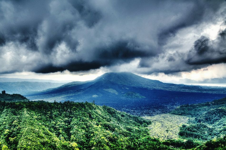 View of Mountbatur on Kintamani - Bali Highland Dark Clouds Comeandsee .... 5 minutes later..rains and fog cover the whole area.
