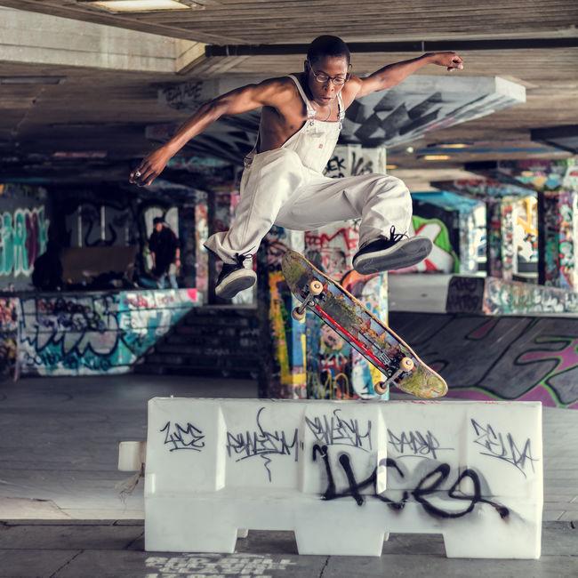Skateboarder trick jump. Action City City Life Cool Exploring Extreme Sports Fashion Flying Foucs Graffiti Jump Leisure Activity Lifestyles Man Moments Outdoors Skate Skateboarding Skatepark Skill  Sport Sports Trick  Urban Youth